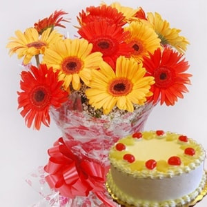 12 Yellow And Orange Gerberas With Half Kg Pineapple Cake