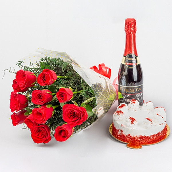 Buy gift combo of 12 Red Roses bunch and half kg Red velvet cake and non alcholic Fiesta champagne.