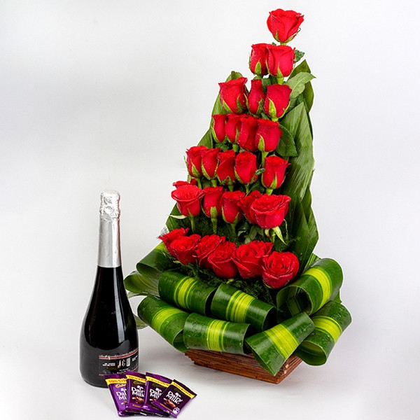 Combo Of Basket Arrangement Of 27 Red Roses With Fruit Champagne And 4 Dairy Milk Chocolate