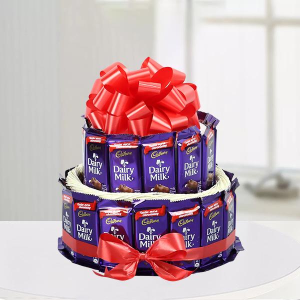 32 Pcs Cadbury Dairy Milk Chocolates Arranged In Two Circular Layers