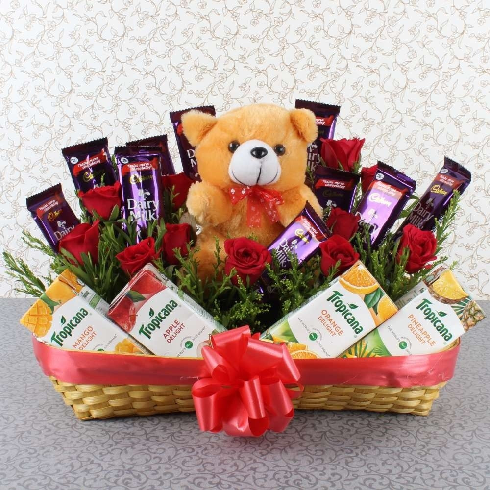 Gift Basket Of 12 Red Roses + 10 Dairy Milk + 4 Pack Of Tropicana Juices + 6 Inch Cute Teddy Bear.