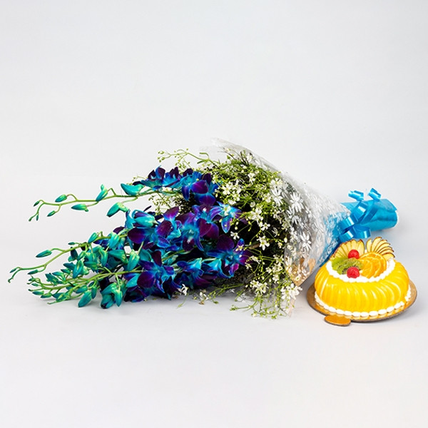 Buy gift combo of beautiful arrangement of 8 blue Orchid with half kg fruit cake