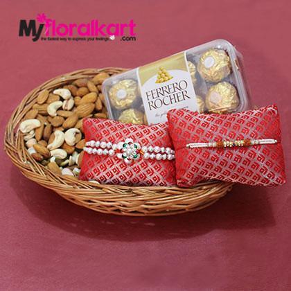 The rakhi set of Ferrero Rocher Chocolate and dried fruits