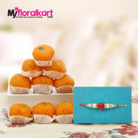 Attractive bead rakhi with delicious Motichoor laddus