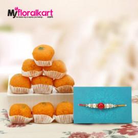 Attractive bead rakhi with delicious Motichoor laddus