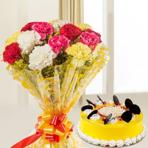 Gift hamper of 12 mix colour carnation bunch with half kg pineapple cake