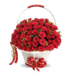 A White Basket Container Of 70 Red Roses