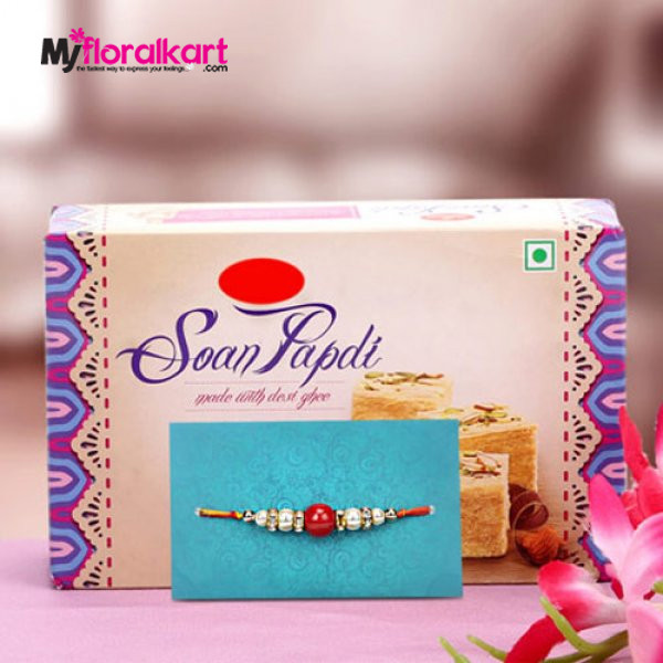 Delightful pearl bead rakhi with son papdis
