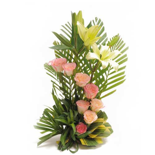 Spring Garden -  A Basket Arrangement Of 8 Pink Roses With 2 White Lilies